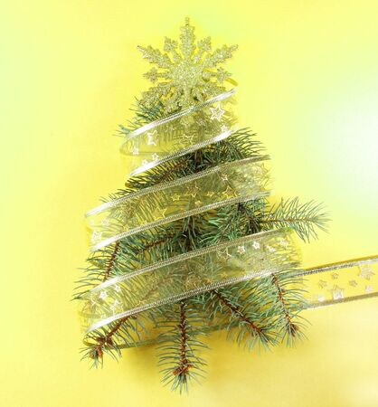 Pine Tree Shape with Golden Ribbon and Snowflake photo