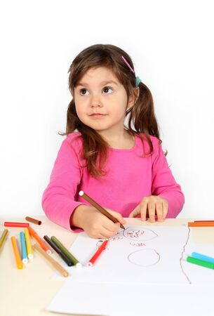 child drawing: Little Cute Girl Drawing with Felt-Tip Pens over White Stock Photo