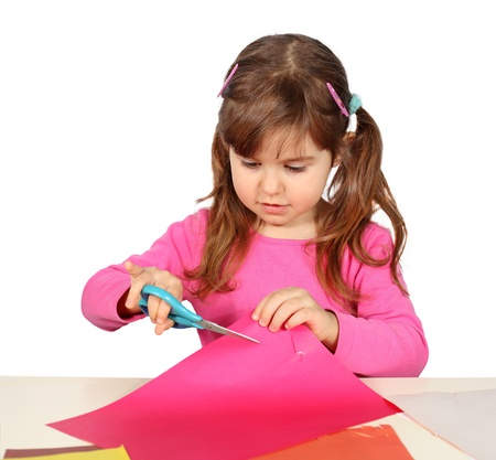 Little Child Girl Cutting with Scissors over White Stock Photo