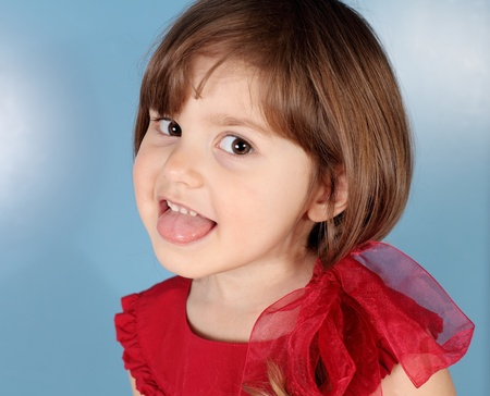 females only: Little Girl Puts out Her Tongue Portrait