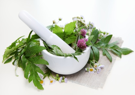 mortar and pestle: Flowers with Healthy Herbs and Mortar Composition