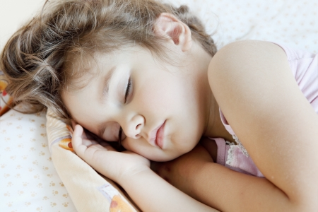 sleeping kid: Little Child Girl Asleep in Her Bed Portrait
