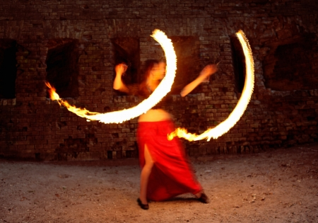Girl Performing with Fire Burning Poi Show Stock Photo