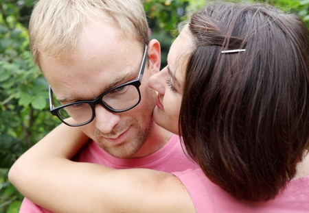 necking: Young Couple Man and Woman Embracing Faces Close