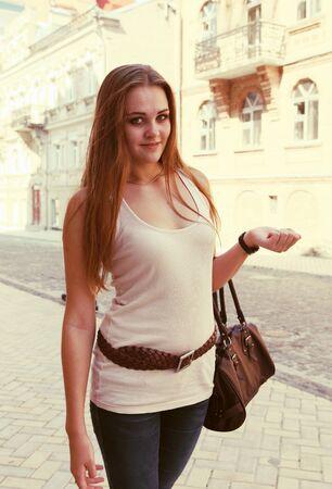 Smiling Woman Walking Down the Street Portrait Stock Photo - 15074936