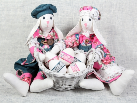Easter Handmade Bunnies with Decorated Eggs in Basket photo