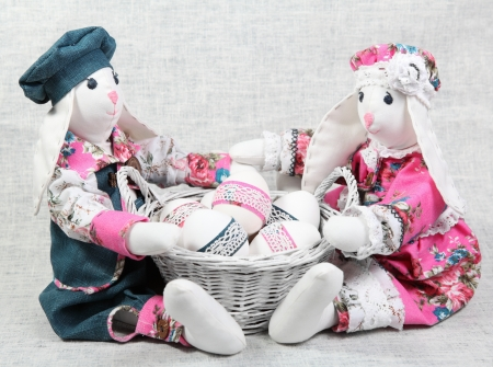 Two Easter Bunnies with Basket of Decorated Eggs photo