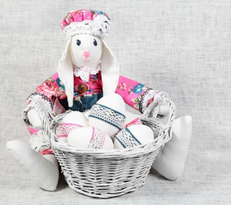 Easter Handmade Bunny Girl with Eggs in Basket photo