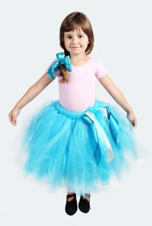 Little Girl Performing in Tutu Skirt Studio Shot over Grey