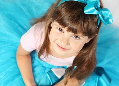 Beautiful Smiling Girl Portrait Studio Shot from Above photo