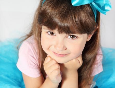 Cute Smiling Girl Portrait Studio Shot over Grey photo