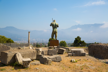 Man statue on the square of the ancient city of Pompei, Naples, Italy.