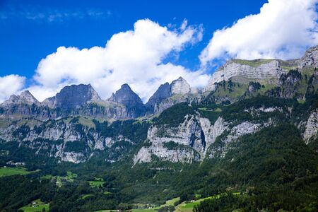 Dolomites Apls, Switzerland panorama. Dolomites Alps landscape, green valley with high mountains and blue sky.