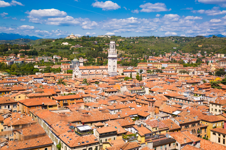 Panoramic cityscape of Verona, Veneto, Italy. Orange tiling medieval roofs. Bright sunny summer day with blue sky.