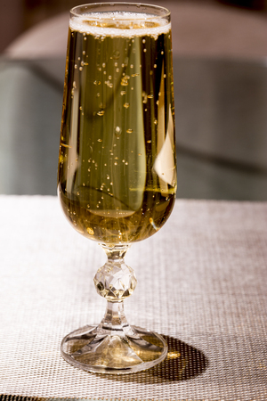 glass of sparking vine, stays on the table 版權商用圖片