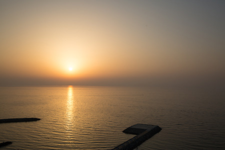 Panoramic view of sunrise and helipad (landing area or platform for helicopters) in the Persian gulf. Stock Photo