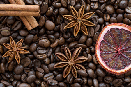 Dried sicilian orange slice, cinnamon sticks  and coffee beans, macro, tio view. Christmas concept. WIntertime.