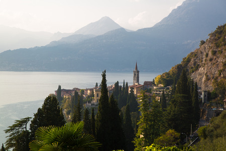 Lake Como, mountains in fog, beautiful evening landscape. Italy, Lombardy. Varenna.