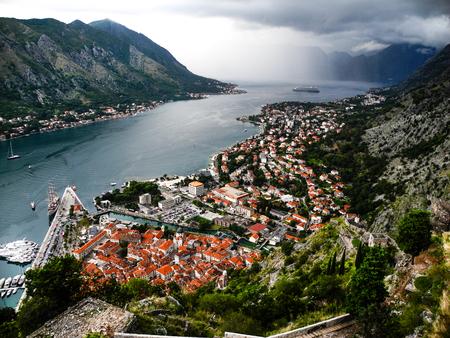 Marvelous panoramic view to Kotor bay, Montenegro. Dark heavy clouds, aerial. Stock Photo
