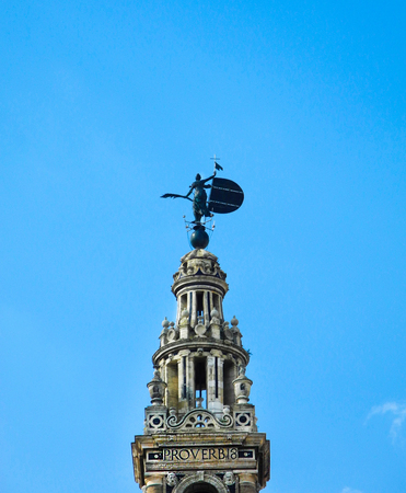 Giralda tower in Sevilla, Spain. Blue sky background.  Moorish architecture. Stock Photo