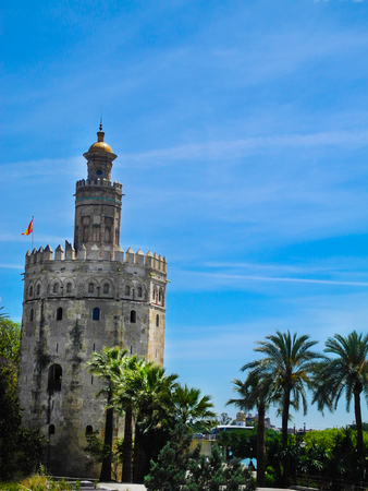 Golden tower (Torre del Oro) in Seville, Spain. Bright summer sky.