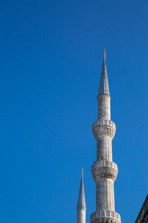 Minarets and bue sky, close up. Blue mosque, Istanbul, Turkey.