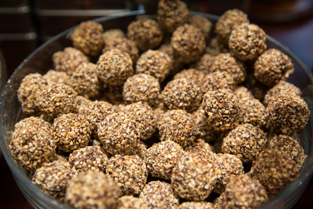 Sweet balls, homemade healthy dessert with dried fruits, cocoa, sesame and nuts. Stok Fotoğraf