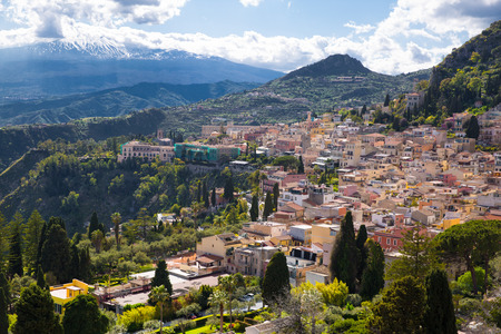 Etna volcano and Taormina town aerial panoramic view. Roofs of a lot of buldings. Sicily island, Italy.