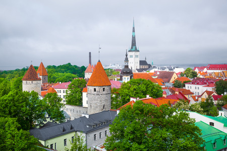 Old Tallinn historic buildings with red tile and st Olaf church, Estonia. Stock fotó