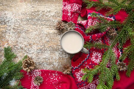 Cup of hot cacao on brown wooden table. White snow and fir tree branches on brown table. Holiday Christmas concept. Stock Photo