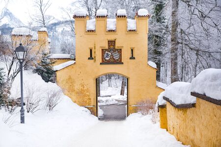 Hohenschwangau fairy-tale castle in Germany in winter. Fussen, Bavaria (Bayern). A lot of snow. Popular tourist attraction. Standard-Bild