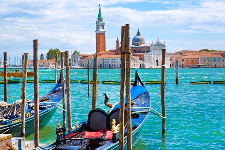 Gondolas on Grand Canal, St Mark church tower and bright turquoise water of canal in Venice, Italy. Sunny summer vacations. 写真素材