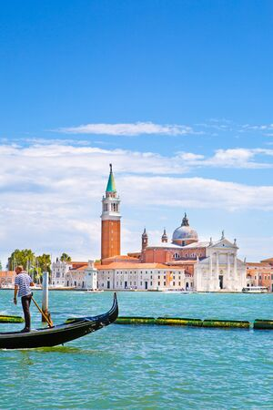 Grand Canal and Gondola, St Mark church tower and bright turquoise water of canal in Venice, Italy. Sunny summer vacations. 写真素材