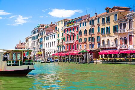 Venice. Grand Canal and old historical colorful medieval buildings. Italy destination, beautiful landscape.