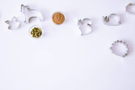 Animal cookie cutters on white table, top view. Cinammon and cardamom spice. Space for text, copy-space. 写真素材