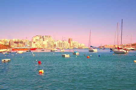 Mediterranean seascape, Malta. Boats and yachts. Beautiful colorful sky.