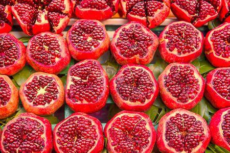 Tasty organic pomegranates, healthy tasty fruit, bright colors.  写真素材