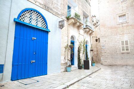 Malta blue door and white walls, street typical Maltese archtecture.