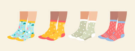 Socks on legs vector illustration set. Cartoon flat collection of underwear accessories, sock pair with colorful ornament, print and pattern, funny warm socks footwear isolated on white