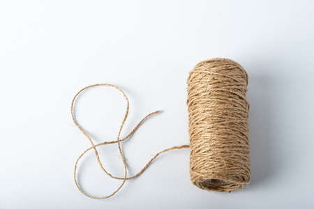 Spool rope on white background. Isolated. Embroidery thread yarn isolated, wool knitting. A set of isolated coils of coarse hemp rope. Stock Photo