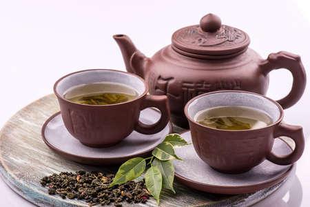 tea set: Green Tea set on a bamboo mat on white background Stock Photo