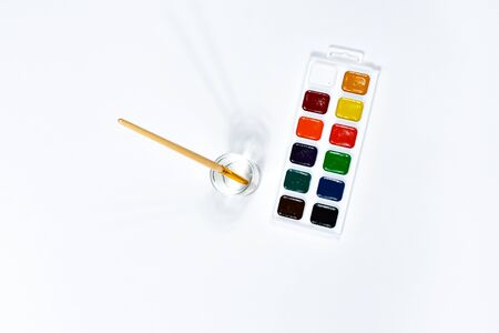 Watercolor paints and brush for drawing. Childrens creativity, painting, early development.