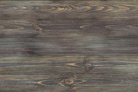 Beautiful wood texture dark background. Dark wood texture. View from above. Horizontal.