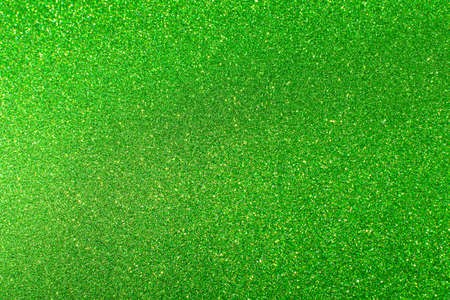 Glamor green sparkling background. Blured glitter background. Holiday abstract texture. Background of blue lights. Foto de archivo