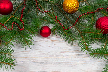 Christmas tree with decoration on a white wooden background. View from above. Place for an inscription. New Year. Christmas