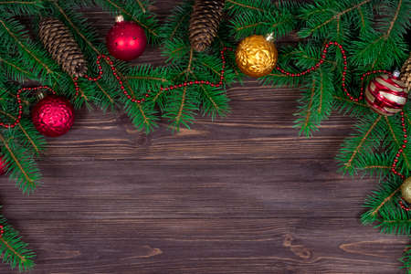 Christmas tree with decoration on a dark wooden background. View from above. Place for an inscription. New Year. Christmas