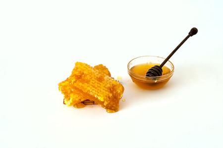 natural honey in honeycombs on white background,copy space, closeup