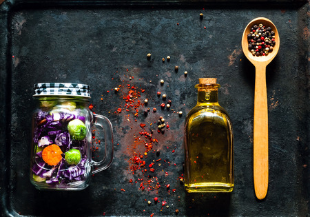 Plant Food  in a glass jars and wooden spoon with spices on vintage rusty metal background.The concept of healthy eating. Copy space, close up. 免版税图像
