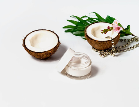 Scrub,coconut products on white background. Festive decor. Copy space, closeup.