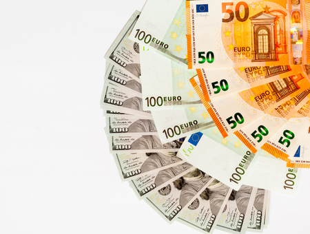 Cash banknotes euro and dollar on isolated white background. Stock Photo